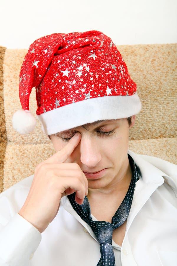 Утомленный подросток в шляпе Санты стоковая фотография rf