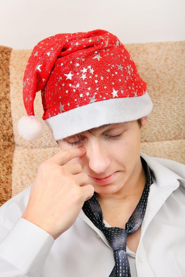 Утомленный подросток в шляпе Санты стоковое фото rf