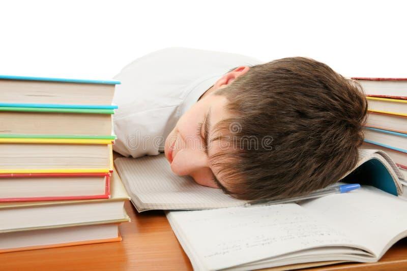 Утомленный сон студента стоковая фотография