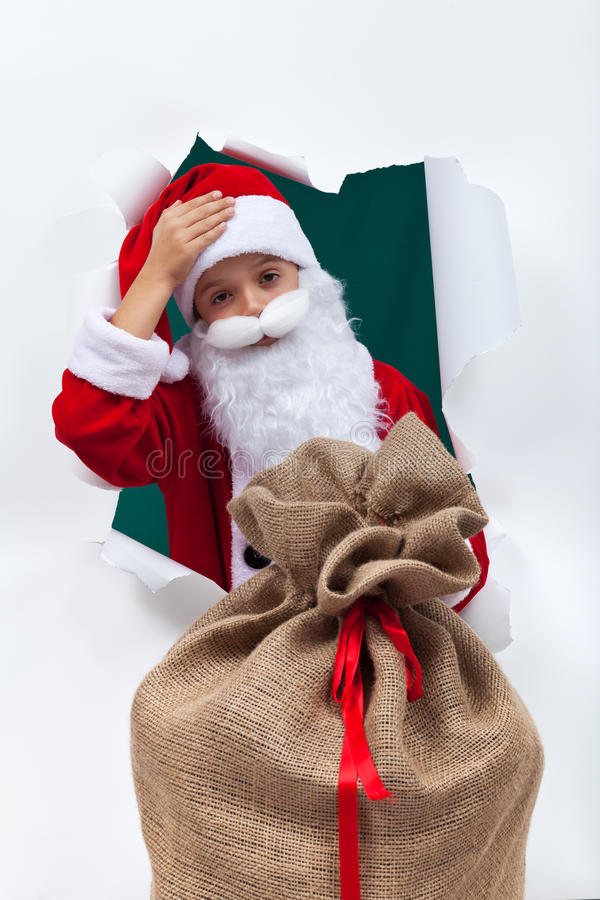 Утомленный santa с большой сумкой стоковые фото