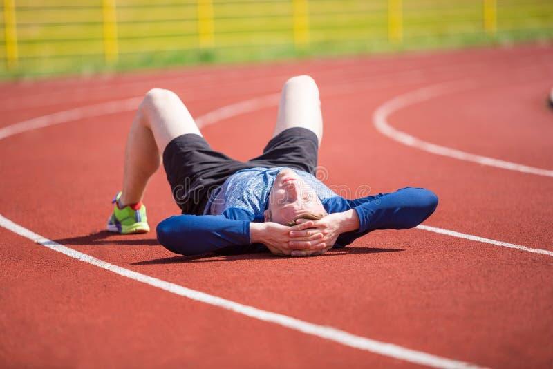 утомлянный спортсмен стоковые фотографии rf