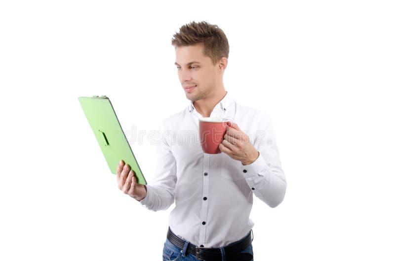 Утро Молодой счастливый бизнесмен держа таблетку стоковое изображение rf