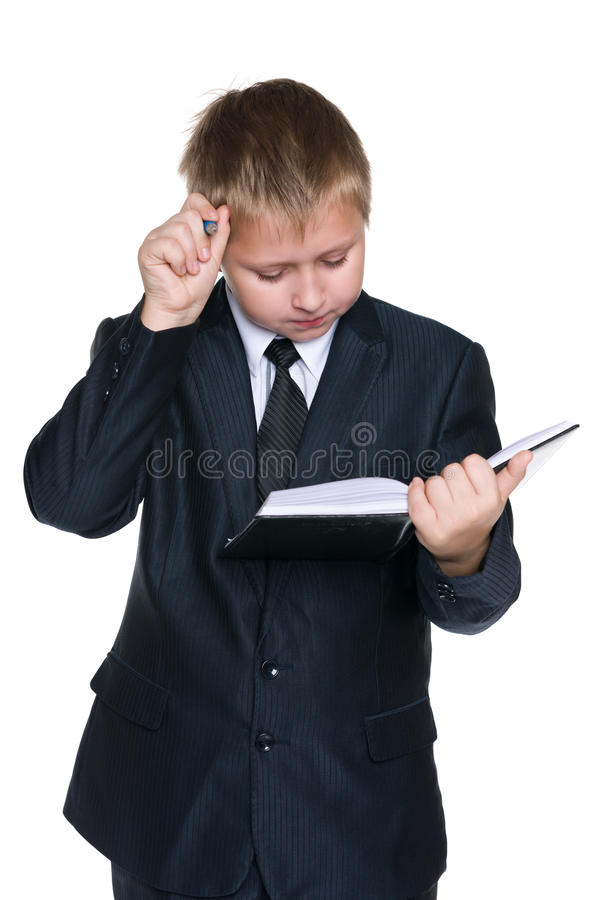 Ухищренный молодой мальчик с тетрадью стоковое изображение