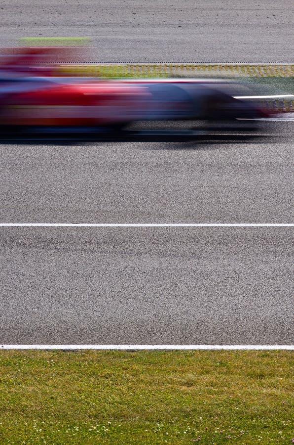 участвовать в гонке автомобиля нерезкости быстрый стоковая фотография