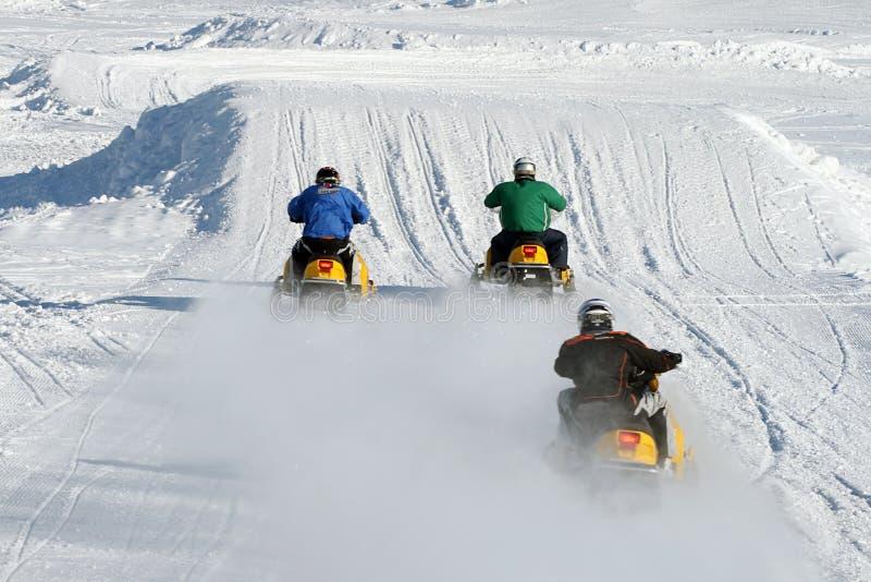участвовать в гонке snowmobile стоковые фото
