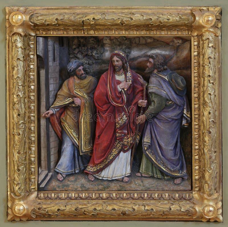 Ученики сталкиваются Иисус на дороге к Emmaus стоковые изображения