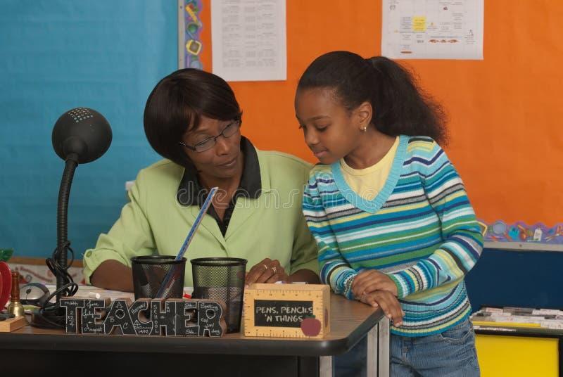учителя студента стола стоковая фотография