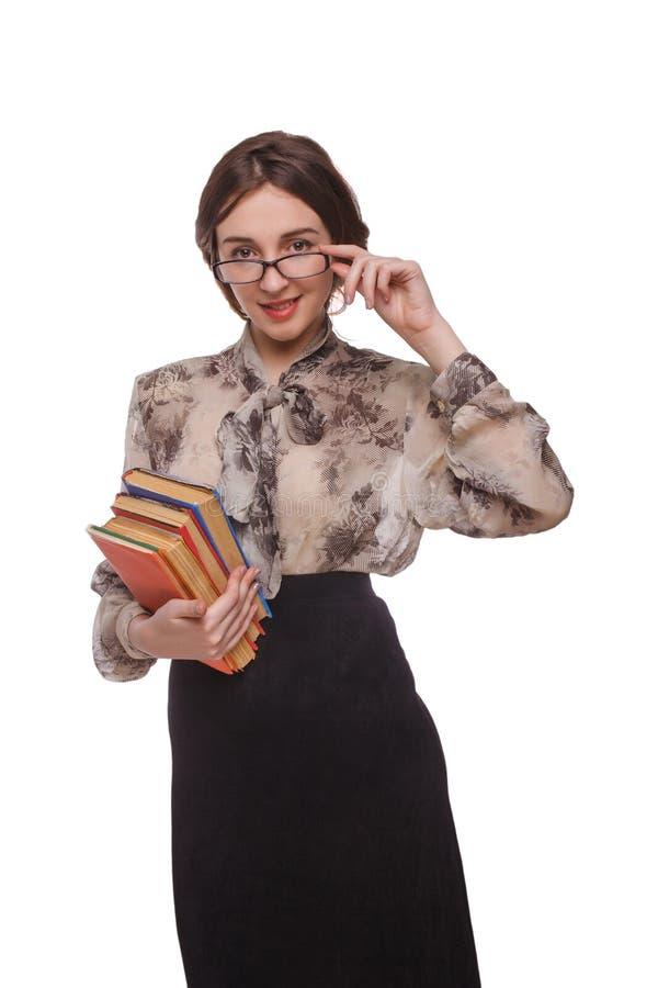 Учитель женщины в стеклах с книгами изолировал белизну стоковые изображения