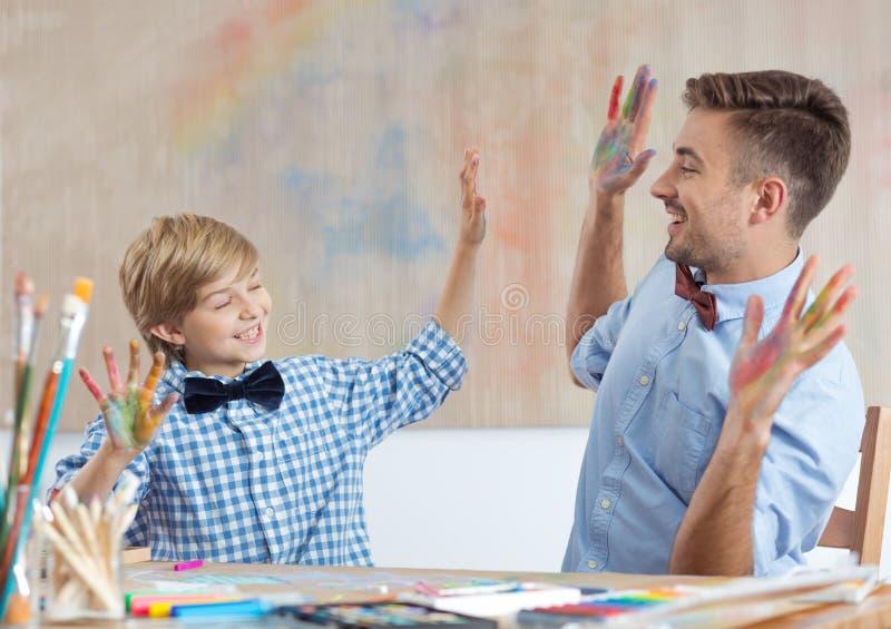 Учитель и зрачок художественного класса стоковое фото rf