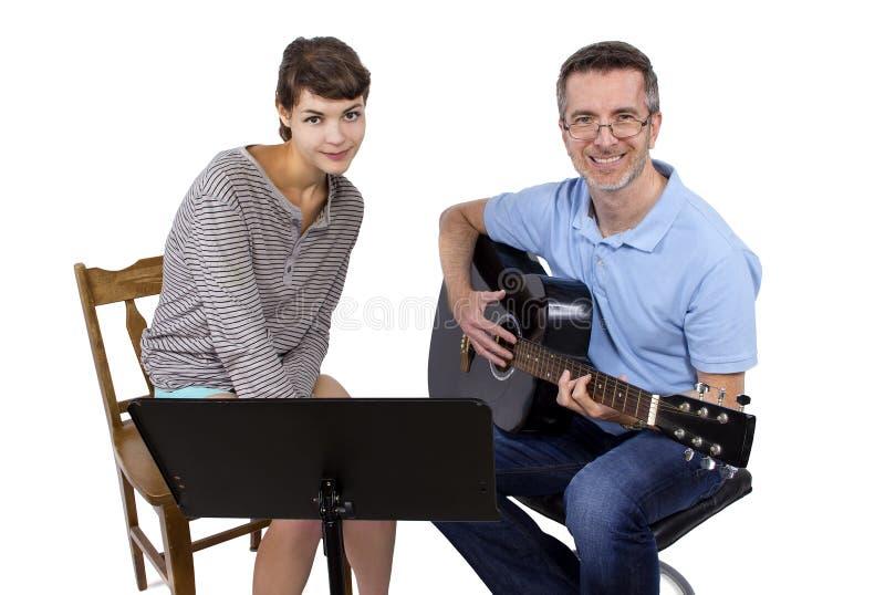 Учитель музыки и студент стоковое изображение rf