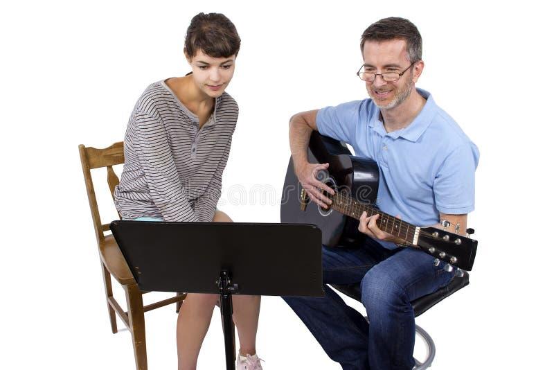 Учитель музыки и студент стоковые фотографии rf