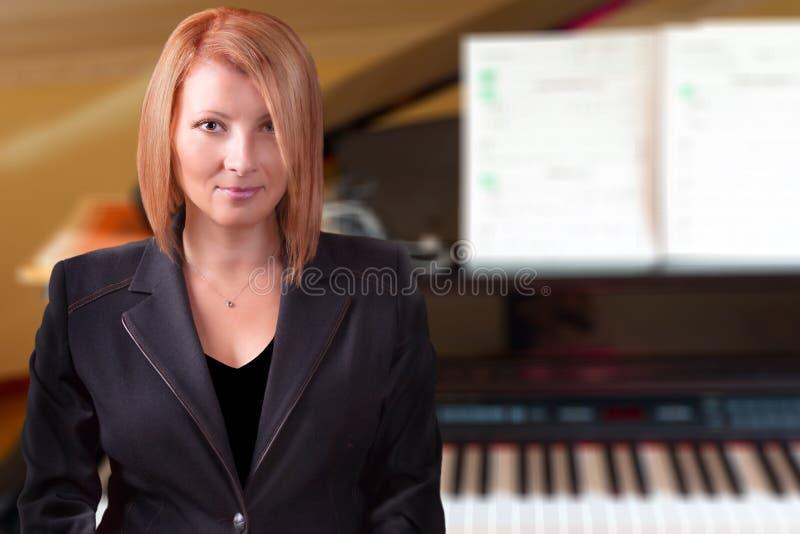 Учитель рояля стоковая фотография rf