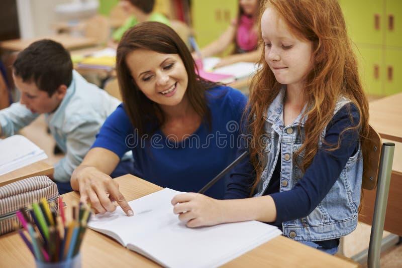 Учитель с студентами стоковая фотография rf