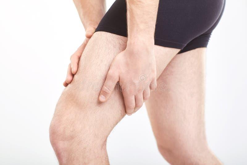Ушиб напряжения мышцы человека в бедренной кости стоковая фотография rf