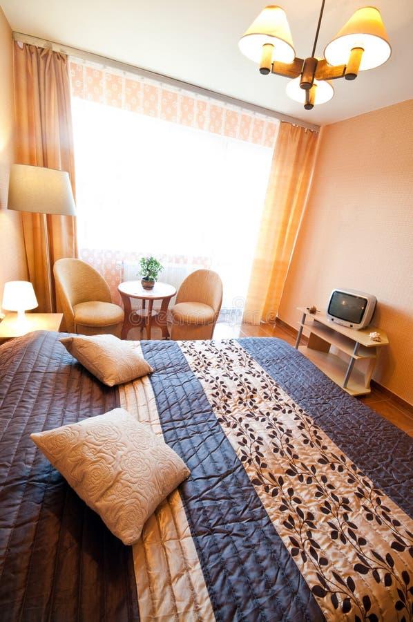 Уютная спальня стоковые фотографии rf