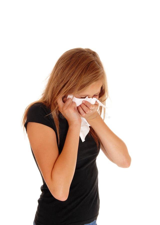 дуя девушка ее маленький нос стоковая фотография rf