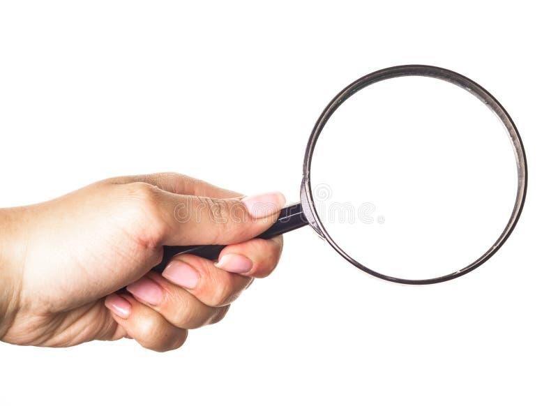 удерживание руки бинарного Кода рассматривая стеклянное увеличивая использующ стоковое изображение