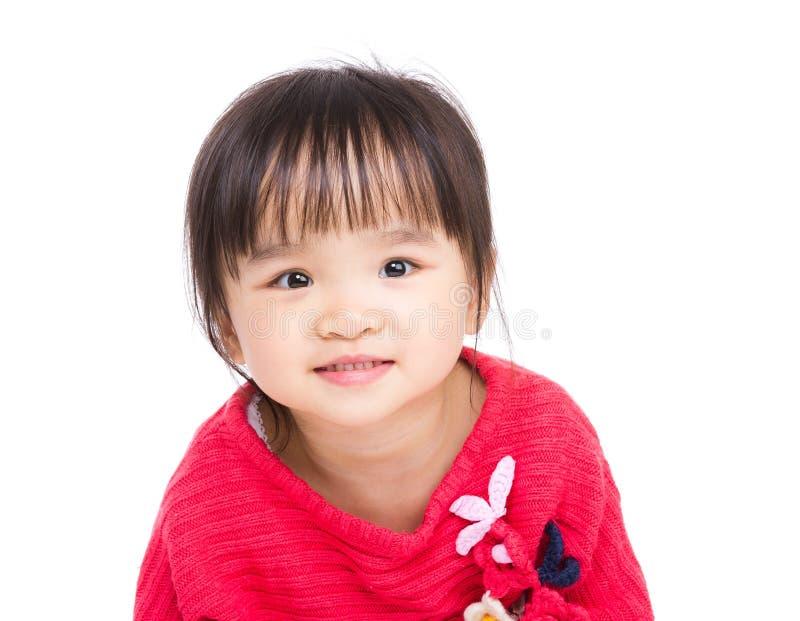 Улыбка маленькой девочки Азии стоковое изображение