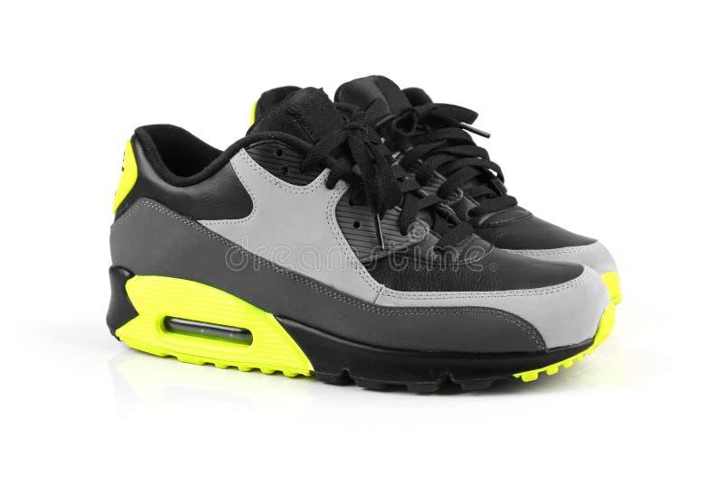 Ультрамодные ботинки спорта изолированные на белизне стоковая фотография rf