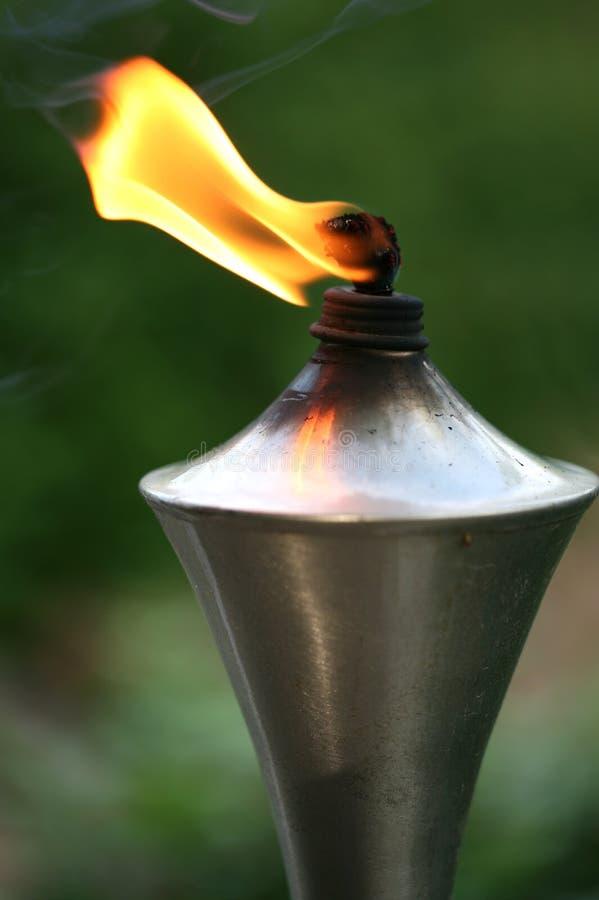 факел освещенный пламенем померанцовый стоковая фотография rf