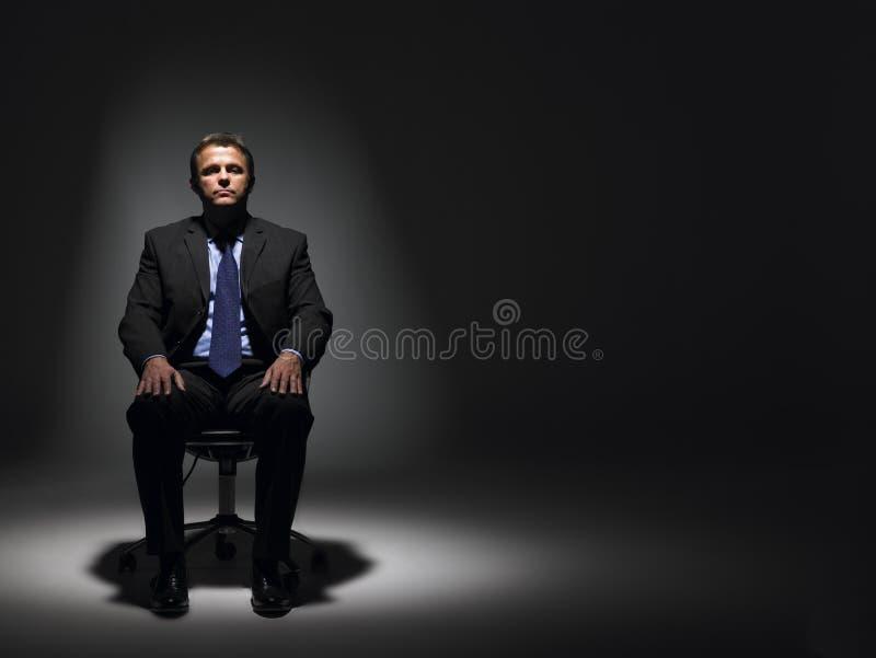 фара бизнесмена сидя стоковое фото rf