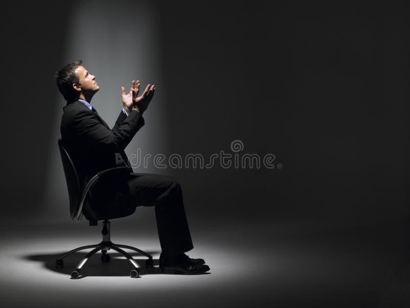 фара бизнесмена сидя стоковая фотография