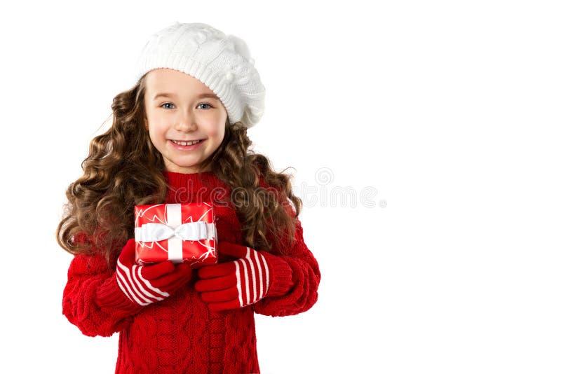 Фасонируйте маленькую девочку при подарок рождества, изолированный на белой предпосылке стоковое изображение rf