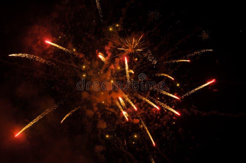 Фейерверки в небе на ноче стоковое фото rf