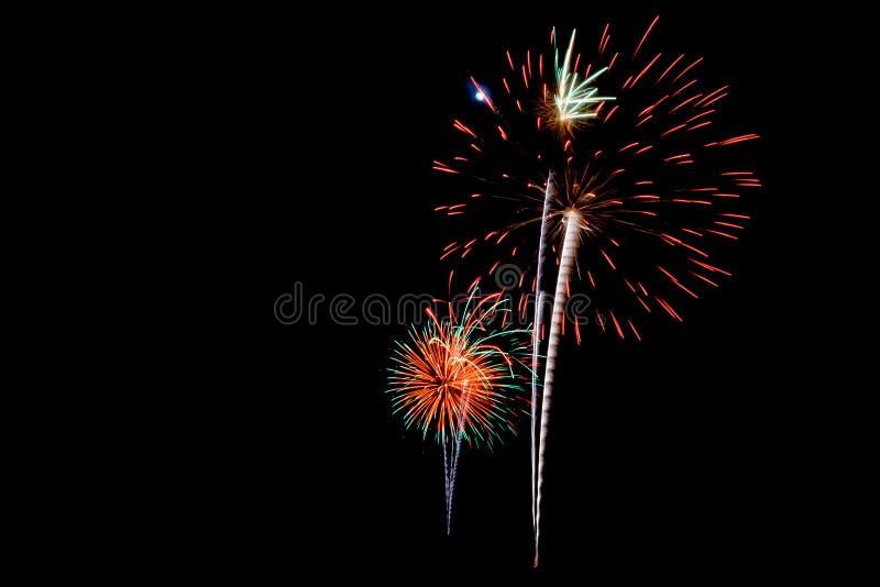 Фейерверки в черной предпосылке стоковое изображение rf