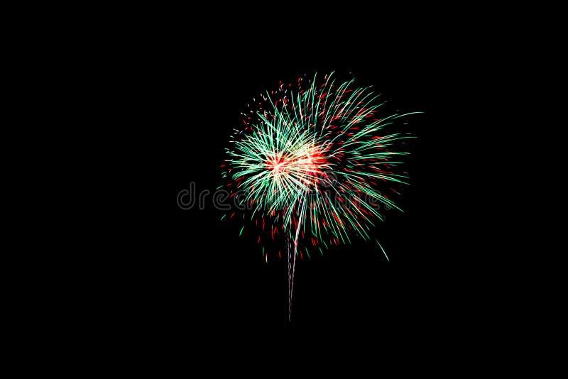 Фейерверки в черной предпосылке стоковое изображение