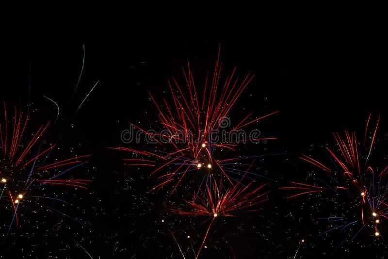 Фейерверки над черным небом стоковая фотография rf