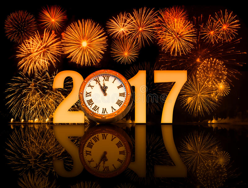 фейерверки 2017 Новых Годов с циферблатом стоковые изображения rf