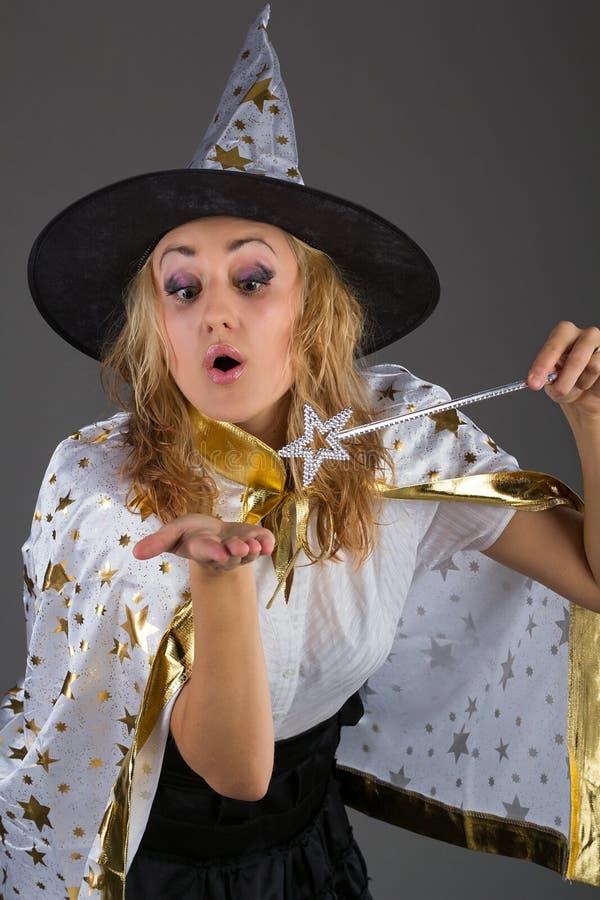 Фея с волшебной палочкой на серой предпосылке стоковая фотография