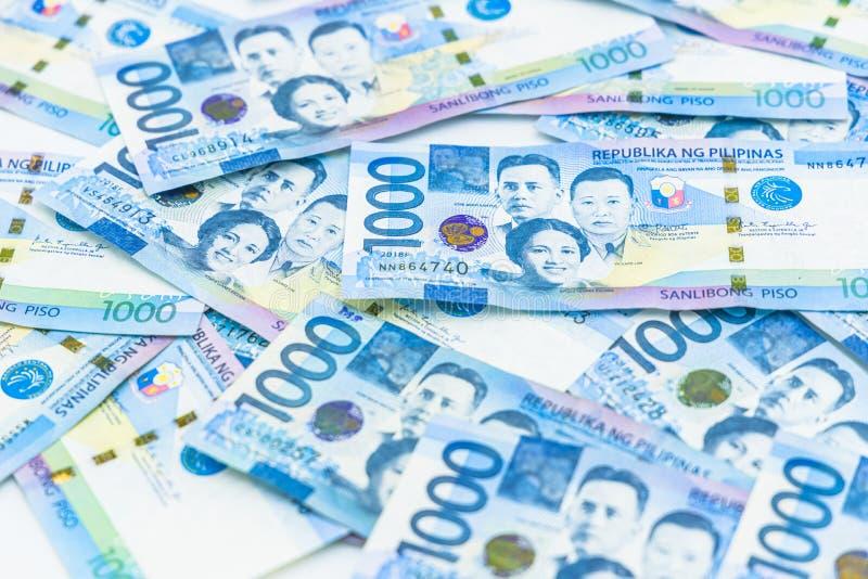Филиппинский счет 1000 песо, валюта денег Филиппин, филиппинская предпосылка счетов денег стоковые изображения