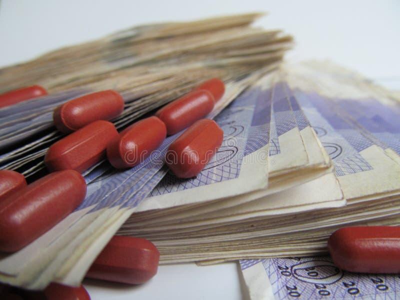 Финансы 3 здоровья денег лекарств стоковое фото