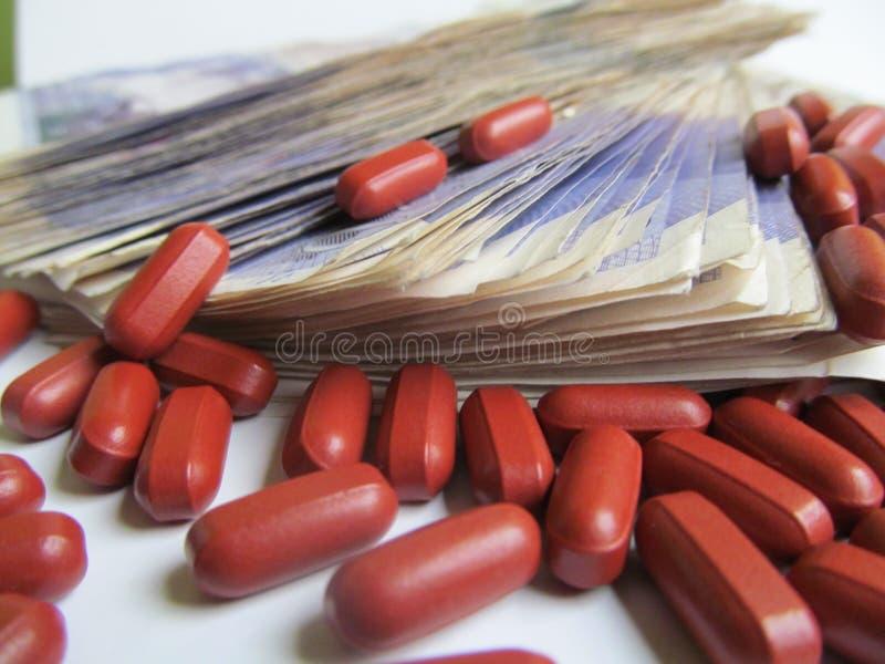 Финансы 4 здоровья денег лекарств стоковое изображение