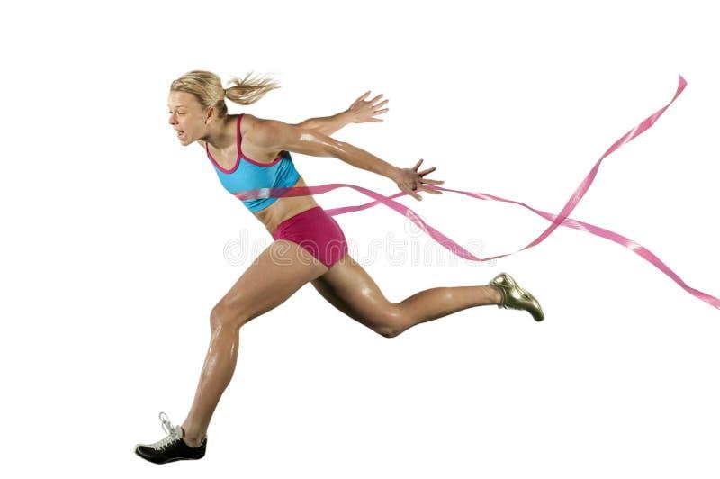 финишная черта спринтер скрещивания стоковая фотография rf