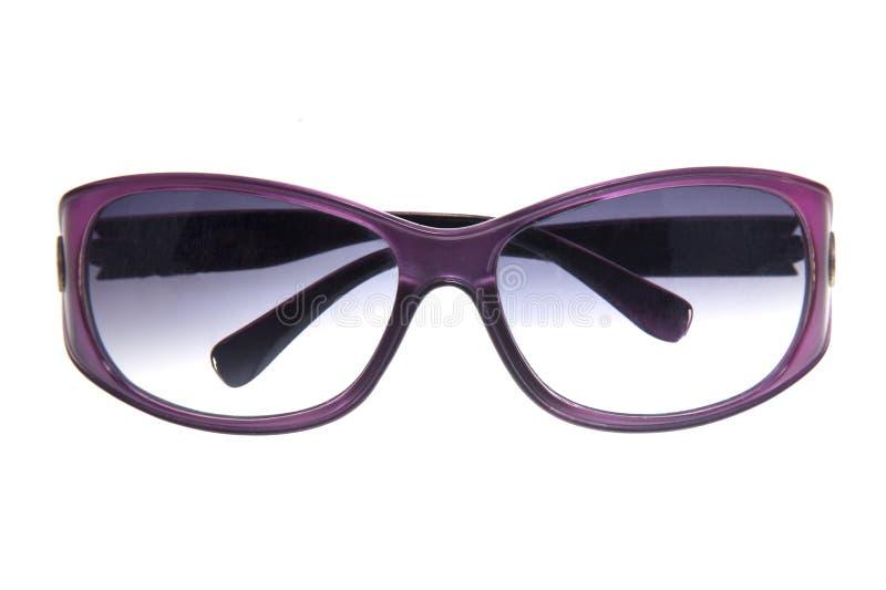 Фиолетовые солнечные очки изолированные на белой предпосылке стоковое изображение rf