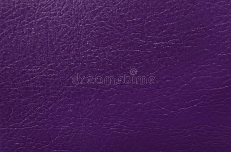 Фиолетовая кожаная предпосылка текстуры стоковые фото