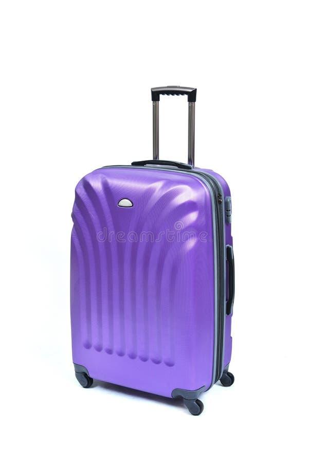 Фиолетовый чемодан стоковая фотография rf