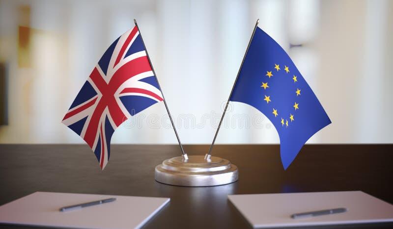 Флаги Великобритании и ЕС на столе Брекситские переговоры между Европейским союзом и Великобританией Иллюстрация трехмерной графи стоковые фото
