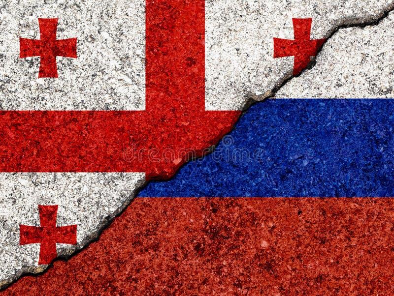 Флаги Грузии и России нарисованы на треснувшем фоне/концепция конфликта Грузии и России стоковое изображение