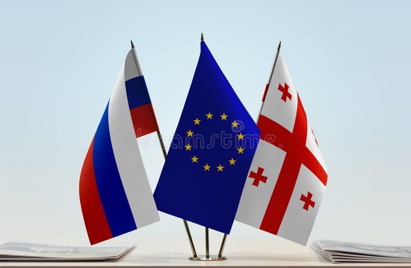 Флаги Европейского союза и Georgia России стоковые фотографии rf
