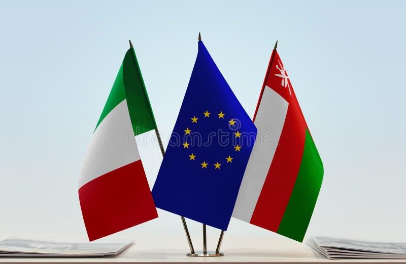 Флаги Италии EC и Омана стоковое изображение