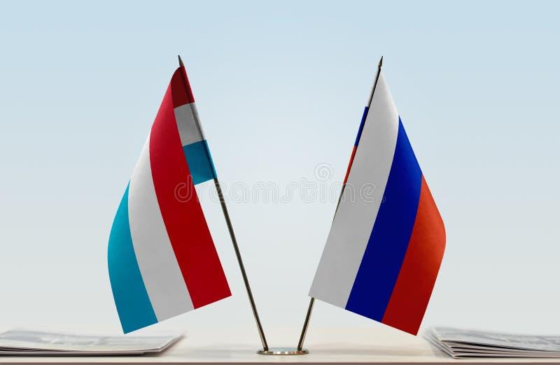 Флаги Люксембурга и России стоковое фото