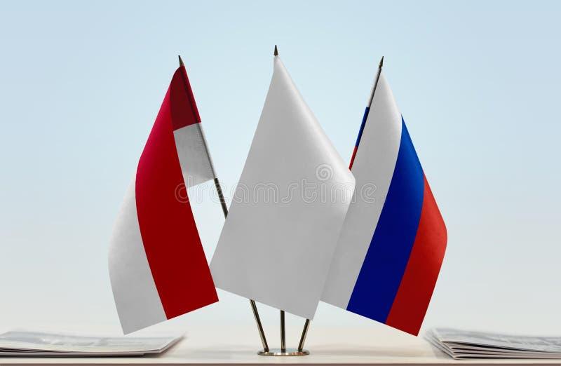 Флаги Монако и России стоковое изображение rf
