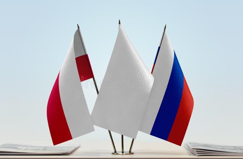 Флаги Польши и России стоковое фото rf