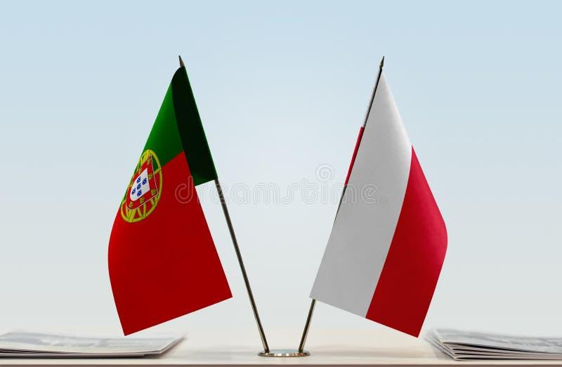 Флаги Португалии и Польши стоковое изображение