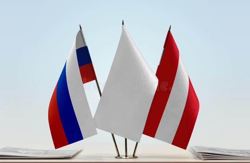 Флаги России и Австрии стоковое изображение
