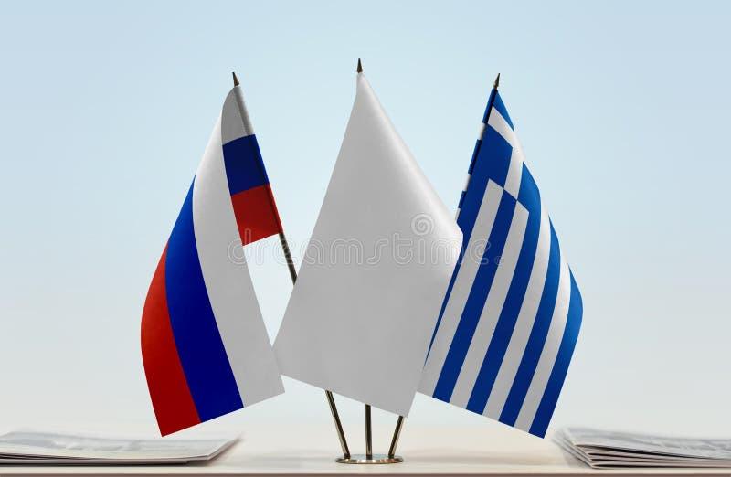 Флаги России и Греции стоковое изображение